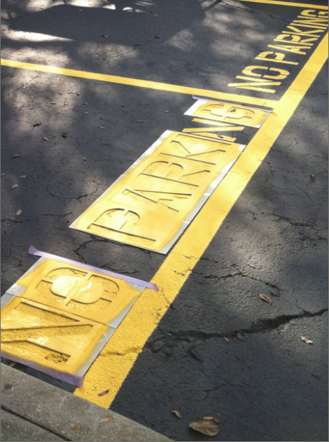 Image of asphalt Stencil by All Florida Striping and Sealcoating